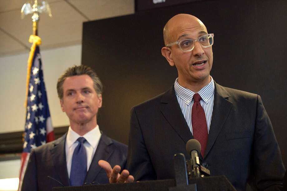 FILE - California Health and Human Services Agency Secretary Dr. Mark Ghaly, right, speaks to members of the press at a news conference in Sacramento, Calif., Thursday, Feb. 27, 2020. Photo: Randall Benton / AP