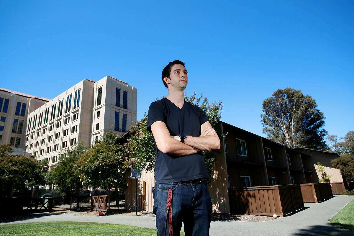 Portrait of Stanford University PHD graduate student Tyler Benster, who photographed in between the new housing in construction on the left and current housing on the right. At Stanford University, California, on Friday, August 7, 2020.