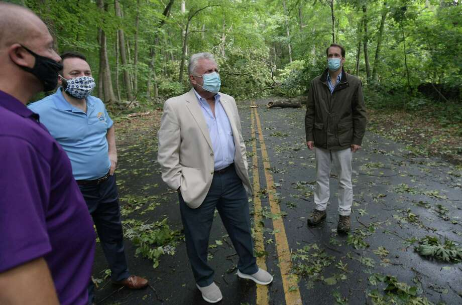 US Congressman Jim Himes, right, tours storm damage with Norwalk officials including mayor Harry Rilling, center, and DPW director Chris Torres, left, Friday August 7, 2020, in Norwalk, Conn. Photo: Erik Trautmann / Hearst Connecticut Media / Norwalk Hour