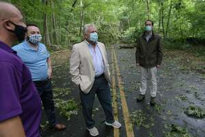 US Congressman Jim Himes, right, tours storm damage with Norwalk officials including mayor Harry Rilling, center, and DPW director Chris Torres, left, Friday August 7, 2020, in Norwalk, Conn.