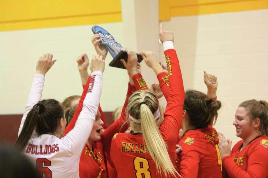 Nina Gorgijevska (6) and her Ferris State volleyball team celebrates winning the league tournament trophy last season. (Pioneer photo/John Raffel)