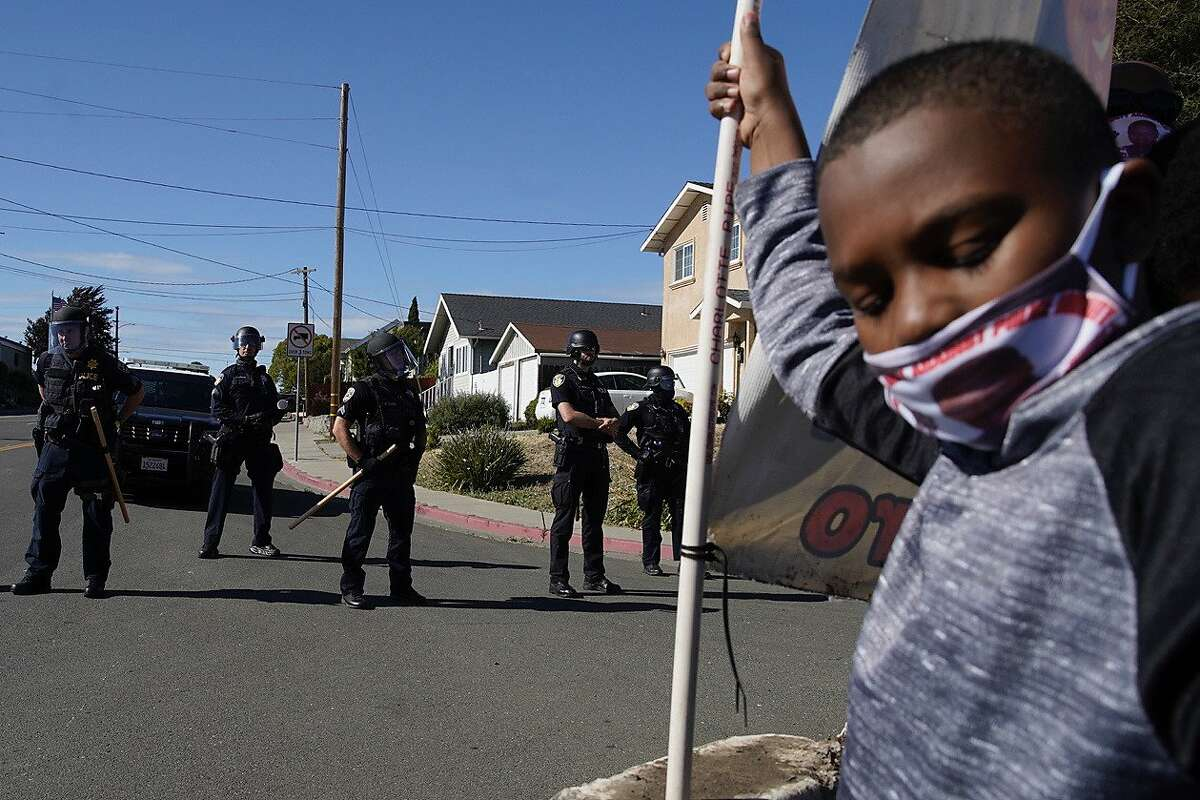 10-year-old Adrian, the nephew of Mario Romero, protests with hundreds of people outside the Vallejo police department on Saturday, June 13, 2020, in Vallejo, Calif.