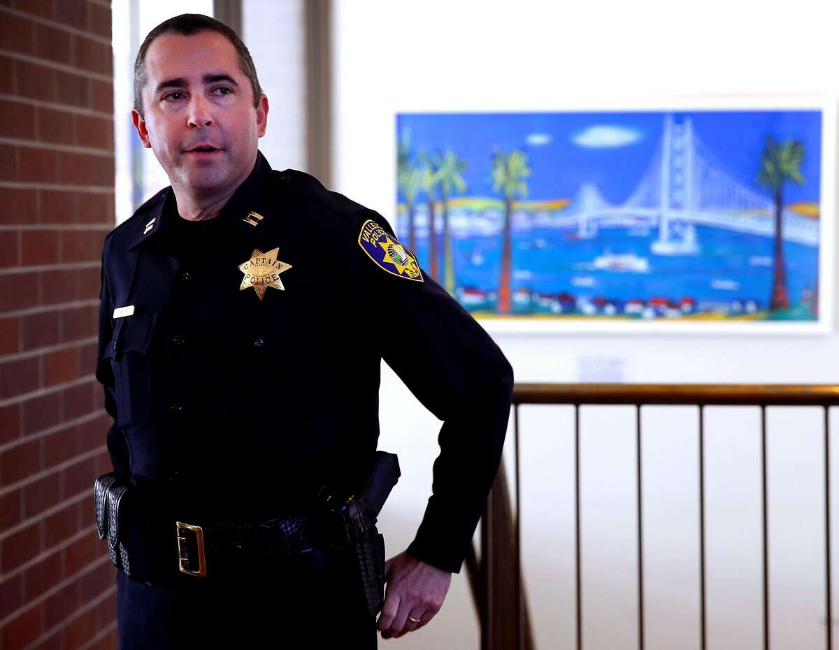 """FILE - In this July 14, 2015, file photo, is Vallejo Police Capt. John Whitney in Vallejo, Calif. The police chief of a San Francisco Bay Area city under scrutiny after several fatal police shootings said Wednesday, July 29, 2020, he is opening an """"official inquiry"""" into allegations that officers bent their badges to mark on-duty fatal shootings. Whitney, a former Vallejo police captain, accused the department of firing him in August for flagging misconduct that included concerns that some officers bent their badges in a ritual to mark fatal shootings."""