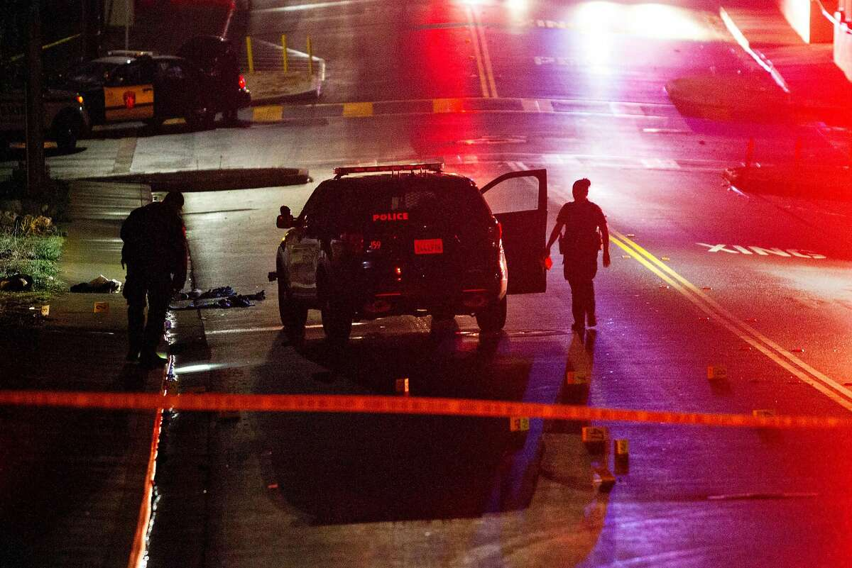 """FILE - In this Oct. 16, 2016, file photo, Vallejo police officers work at the scene of an officer-involved shooting in Vallejo, Calif. The police chief of a San Francisco Bay Area city under scrutiny after several fatal police shootings says he is opening an """"official inquiry"""" into allegations that officers bent their badges to mark on-duty fatal shootings. Vallejo Police Chief Shawny Williams told the San Francisco Chronicle Wednesday, July 30, 2020, that badge bending would amount to misconduct and that a fact-finding mission may lead to an independent investigation."""