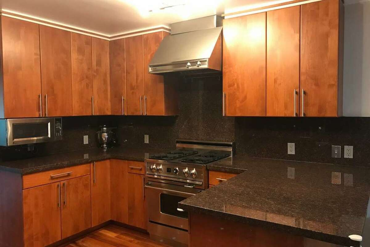 Half a flight downstairs is a fully remodeled kitchen. There's also a breakfast room and a formal dining room.