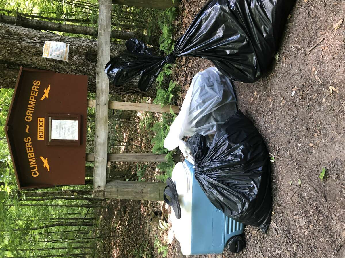 Garbage left behind by campers litters a spot near the pond on Crane Mountain in June. (Courtesy of Jacob Gaechter)