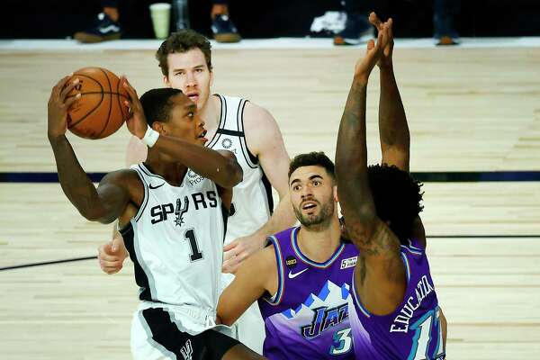 Spurs guard Lonnie Walker IV, left, bounced back from two subpar outings with 14 points against the Jazz on Friday, including a key 3-pointer that helped seal the victory.