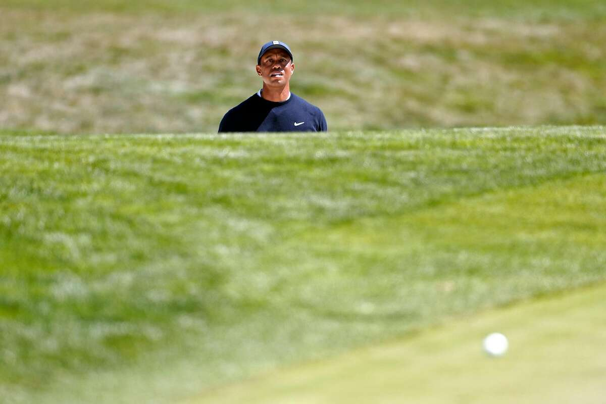 Tiger Woods watches his bunker shot while making par ion 4th hole during 2nd round of PGA Championship at TPC Harding Park in San Francisco, Calif., on Friday, August 7, 2020.