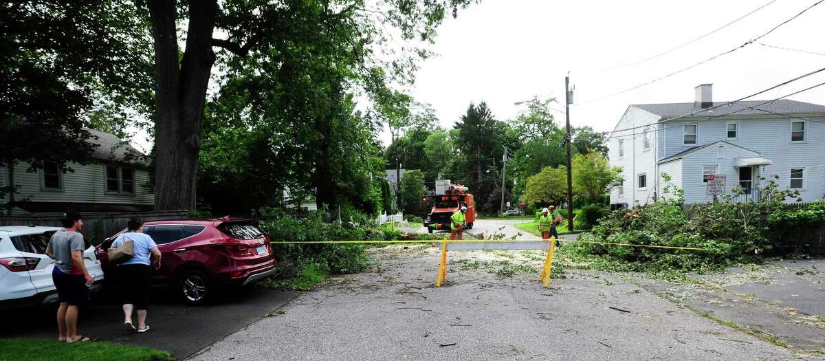 A tree service crew cut up a fallen tree on Frisbie Street on August 7, 2020 in Stamford, Connecticut.