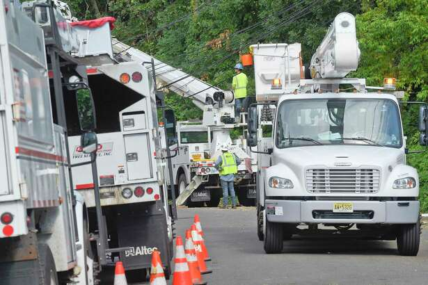 A utility crew works to erect a downed pole Aug. 7, 2020 in Stamford.