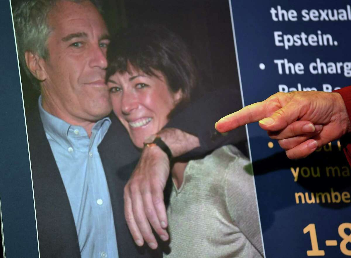 (FILES) In this file photo taken on July 2, 2020 a photo of Ghislaine Maxwell and Jeffrey Epstein is seen as acting US Attorney for the Southern District of New York, Audrey Strauss, announces charges against Maxwell during a press conference in New York City. - A New York court on July 31, 2020 has unsealed emails between accused sex trafficker Ghislaine Maxwell and her former partner, the disgraced late financier Jeffrey Epstein. They show correspondence between the pair in 2015, despite Maxwell's lawyers claiming earlier this month that she had no contact with Epstein in more than a decade. (Photo by Johannes EISELE / AFP) (Photo by JOHANNES EISELE/AFP via Getty Images)
