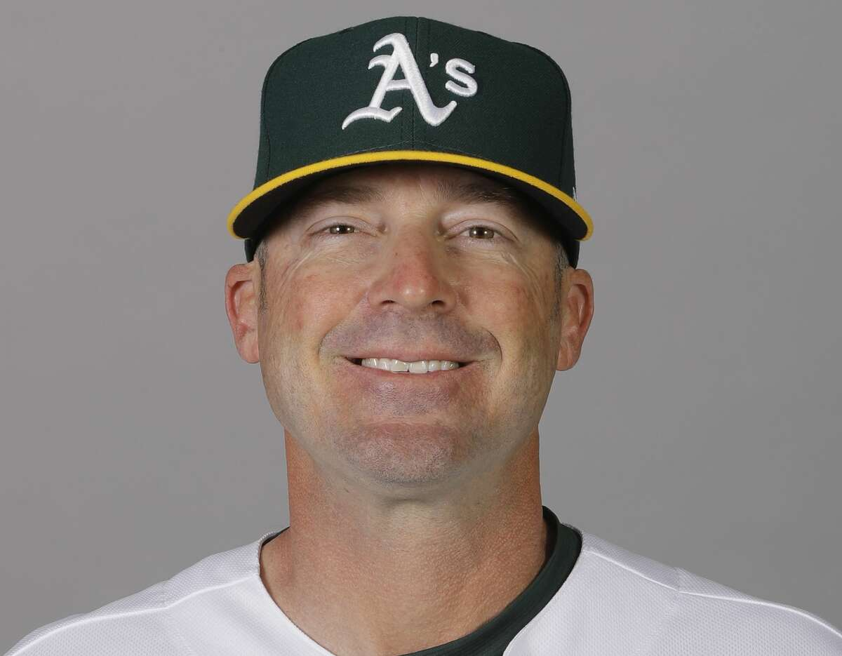 FILE - In this Feb. 20, 2020, file photo, Ryan Christenson, of the Oakland Athletics baseball team, poses for a photo in Mesa, Ariz. Major League Baseball has been in touch with the Athletics about bench coach Christenson making a gesture that appeared to be a Nazi salute following a win over the Texas Rangers. There has been no discipline announced against Christenson. He has apologized for raising his arm during a postgame celebration Thursday, Aug. 6, 2020. The team is giving him the benefit of the doubt that he intended no harm. (AP Photo/Darron Cummings, File)