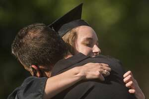 Graduating seniors from Bullock Creek High School celebrate with family and friends during a commencement ceremony Friday, Aug. 7, 2020 at the school. (Katy Kildee/kkildee@mdn.net)