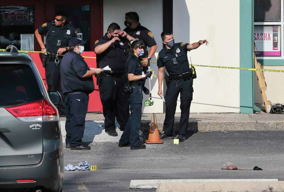 San Antonio police investigate the scene of shooting at Windcrest Square at the intersection of Walzem Road and Montgomery Drive on Friday. Two 16-year-old individuals were shot and taken to SAMMC. Police were looking for a suspect — a man in his 20s — who fled the scene. Photo: Kin Man Hui /Staff Photographer / **MANDATORY CREDIT FOR PHOTOGRAPHER AND SAN ANTONIO EXPRESS-NEWS/NO SALES/MAGS OUT/ TV OUT