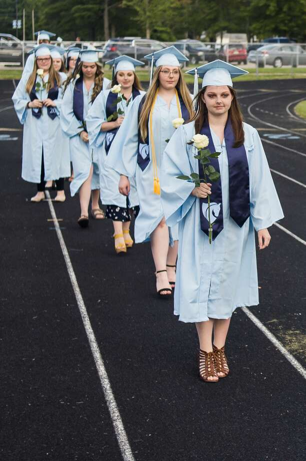 Graduating seniors from Meridian Early College High School celebrate with family and friends during a commencement ceremony Friday, Aug. 7, 2020 at the school. (Katy Kildee/kkildee@mdn.net) Photo: (Katy Kildee/kkildee@mdn.net)