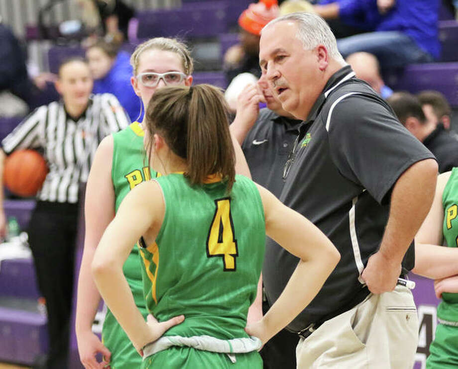 Southwestern girls basketball coach Steve Wooley (right) talks with junior Josie Bouillon (4) while Annie Gallaher looks on during a game vs. Nashville at the Breese Central Shootout on Jan. 4 in Breese. Wooley, also the school's athletics director, is entering his final year in both those roles before retirement in 2021. Photo: Greg Shashack / The Telegraph