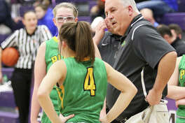 Southwestern girls basketball coach Steve Wooley (right) talks with junior Josie Bouillon (4) while Annie Gallaher looks on during a game vs. Nashville at the Breese Central Shootout on Jan. 4 in Breese. Wooley, also the school's athletics director, is entering his final year in both those roles before retirement in 2021.