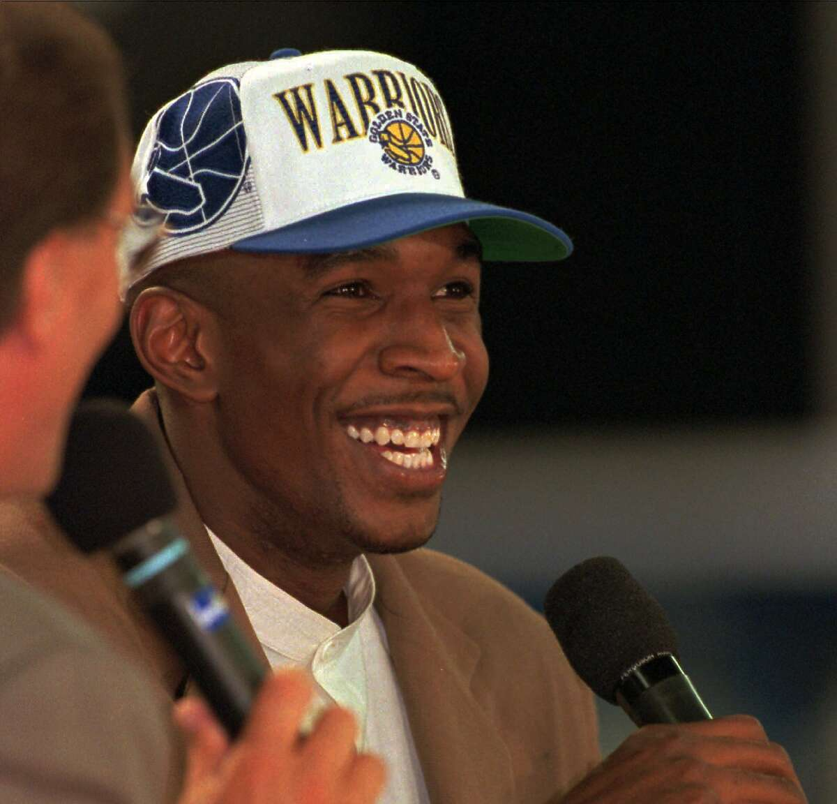 Golden State Warriors' Joe Smith of Maryland smiles during a TV interview after being picked first in the NBA draft Wednesday, June 28, 1995, at SkyDome in Toronto. (AP Photo/Bill Sikes)