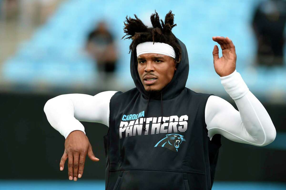 FILE - In this Sept. 12, 2019, file photo, Carolina Panthers quarterback Cam Newton warms up prior to the team's NFL football game against the Tampa Bay Buccaneers in Charlotte, N.C. The New England Patriots have reached an agreement with free-agent quarterback Newton, bringing in the 2015 NFL Most Valuable Player to help the team move on from three-time MVP Tom Brady, a person with knowledge of the deal told The Associated Press. (AP Photo/Mike McCarn, File)