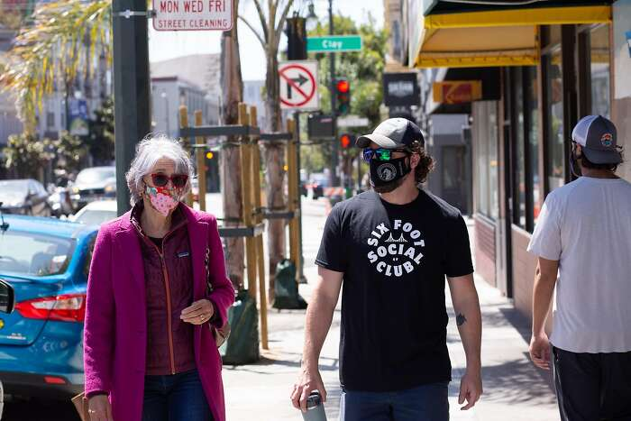 Suzanne Markel-Fox the Discover Polk CBD (Community Benefit District) chair of the board (left) and Ben Bleiman the Discover Polk CBD co-executive director (right) discuss plans to support local businesses hit by COVID-19 on Polk Street in San Francisco, Calif. on Friday, August 7, 2020.