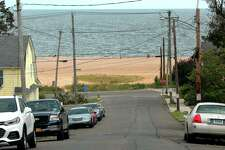 Views of the beach from Ivy Street in West Haven Aug. 6, 2020. At the height of summer, side streets near the beach are more packed then ever with out of town parking, but cops are enforcing parking restrictions.