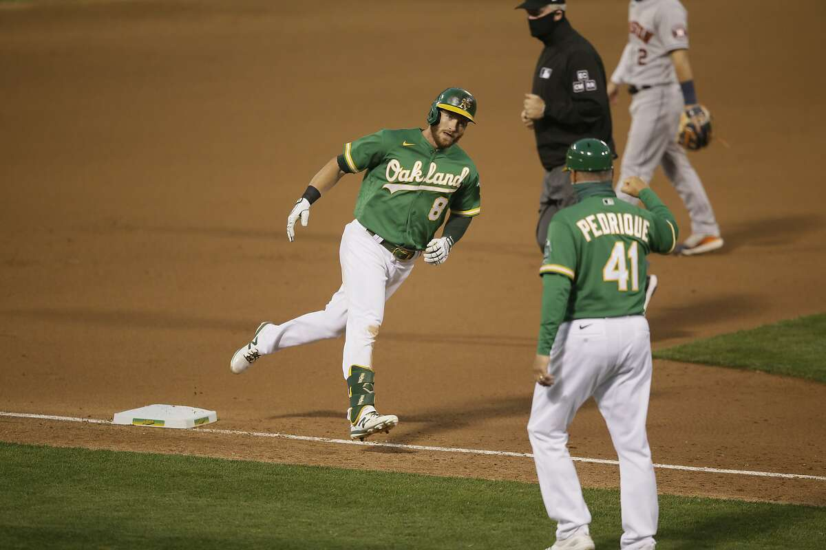 Oakland Athletics left fielder Robbie Grossman (8) runs home after his solo homer in an MLB game against the Houston Astros at RingCentral Coliseum on Friday, Aug. 7, 2020, in Oakland, Calif.The A's Robbie Grossman has 19 hits this season, 11 of which have been for extra bases. He has more walks (15) than strikeouts (14) and hit .343 with four home runs and nine RBIs over his last 11 games.