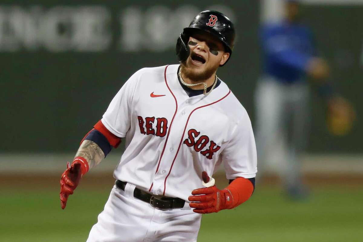 Boston Red Sox's Alex Verdugo rounds third base on his solo home run during the second inning of a baseball game against the Toronto Blue Jays, Friday, Aug. 7, 2020, in Boston. (AP Photo/Michael Dwyer)