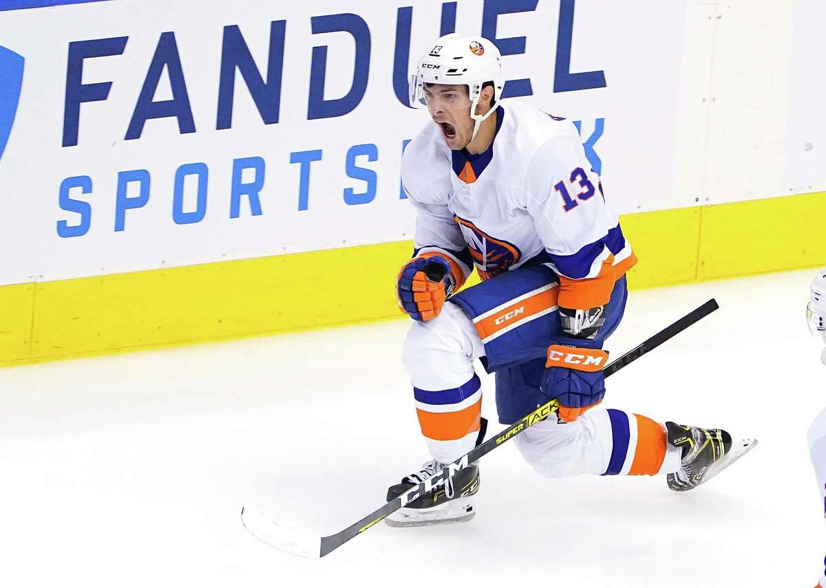 TORONTO, ONTARIO - AUGUST 07: Mathew Barzal #13 of the New York Islanders celebrates his goal in the third period against the Florida Panthers in Game Four of the Eastern Conference Qualification Round prior to the 2020 NHL Stanley Cup Playoffs at Scotiabank Arena on August 07, 2020 in Toronto, Ontario. (Photo by Andre Ringuette/Freestyle Photo/Getty Images)