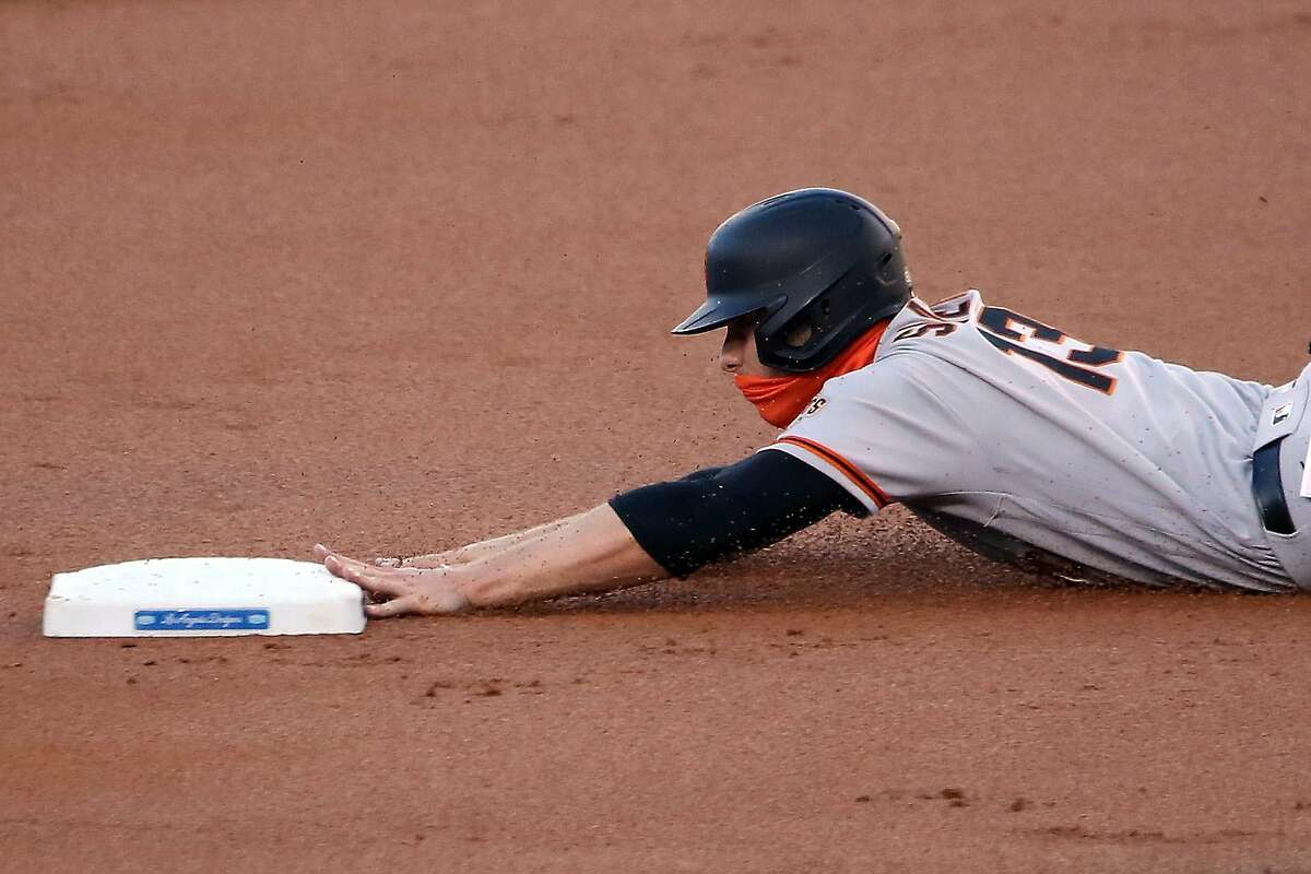 LOS ANGELES, CALIFORNIA - AUGUST 07: Austin Slater #13 of the San Francisco Giants steals second base during the first inning against the Los Angeles Dodgers at Dodger Stadium on August 07, 2020 in Los Angeles, California. (Photo by Katelyn Mulcahy/Getty Images)
