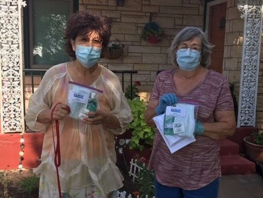 RSVP members Elsa Cooper of Lockney and Sherry Hacker of Floydada recently distributed volunteer kits to its members in area counties. Photo: Provided By RSVP