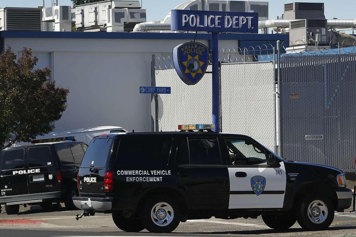 """FILE - In this July 14, 2015, file photo, a police vehicle arrives at the department's headquarters in Vallejo, Calif. The police chief of a San Francisco Bay Area city under scrutiny after several fatal police shootings says he is opening an """"official inquiry"""" into allegations that officers bent their badges to mark on-duty fatal shootings. Vallejo Police Chief Shawny Williams told the San Francisco Chronicle Wednesday, July 29, 2020, that badge bending would amount to misconduct and that a fact-finding mission may lead to an independent investigation. (Paul Chinn/San Francisco Chronicle via AP, File)"""