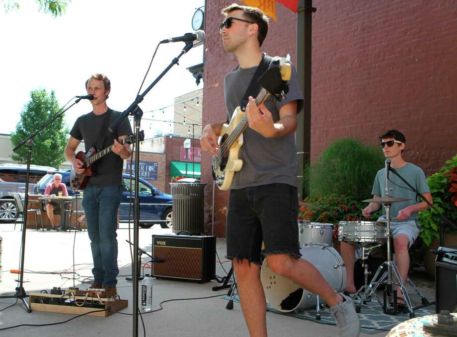 The Balsam Brothers returned to downtown Big Rapids to perform during the weekly Pocket Park Concert Series on Friday. Audience memberslistened to the sounds of progressive rock as they enjoyed the sunny afternoon. (Pioneer photo/Taylor Fussman)