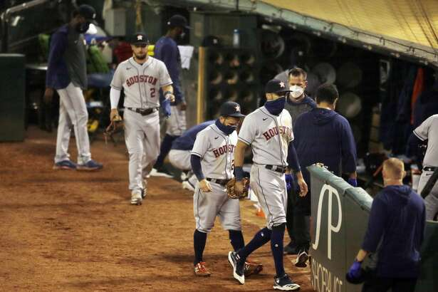 Houston Astros shortstop Carlos Correa (1) and Houston Astros second baseman Jose Altuve (27) exit after losing in an MLB game against the Oakland Athletics at RingCentral Coliseum on Friday, Aug. 7, 2020, in Oakland, Calif. The A's won 3-2.