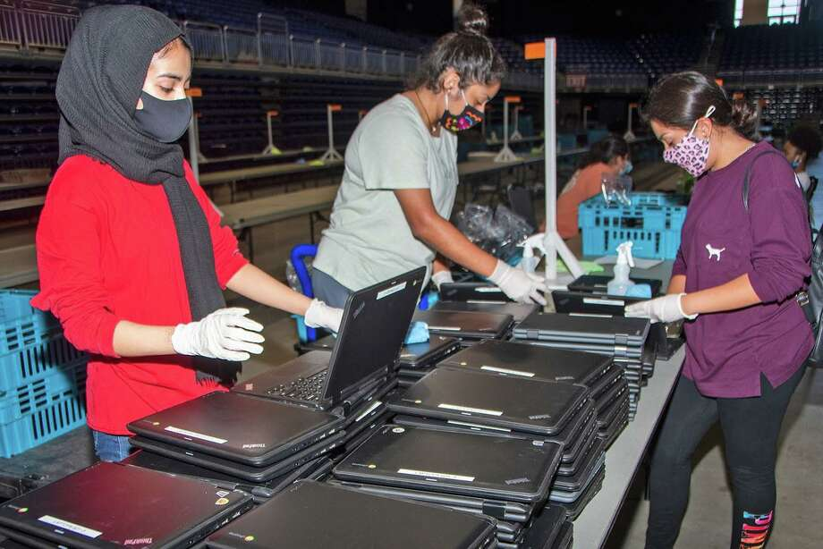 Devices for Cy-Fair ISD students are prepared for distribution. Photo: Courtesy Of Cy-Fair ISD / Submitted