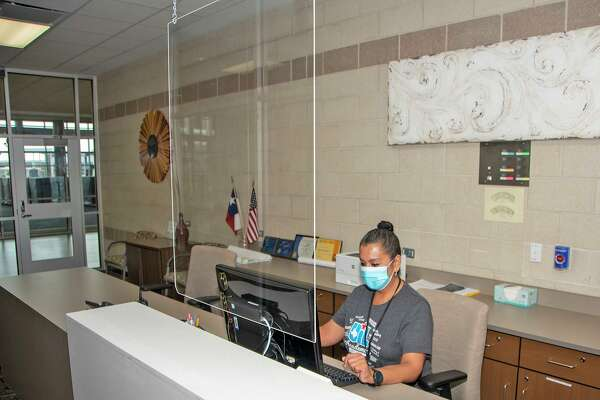 Protective shields guard Cy-Fair ISD staff members on campuses during the coronavirus pandemic.