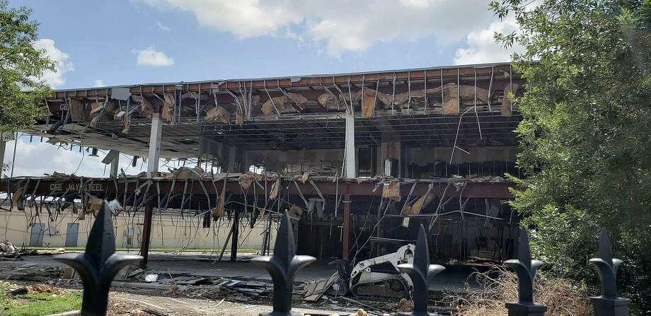 After years of mounting complaints and calls made to law enforcement and the fire marshal, the Mill Creek Office Building at 4702 FM 1960 W has finally met the wrecking ball and was razed last week. Photo: Submitted