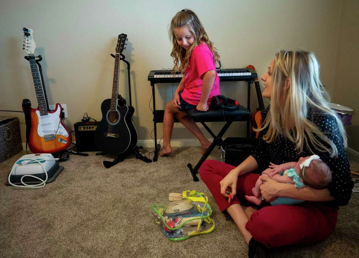 Cashlee, 8, takes a brief break form playing the piano to chat with her mother Melody O'Dell inside her playroom Friday, July 31, 2020, in Houston. Melody and Cody have elected to send Cashlee back to Summerwood Elementary School in Humble ISD once the districts resumes in-person classes.