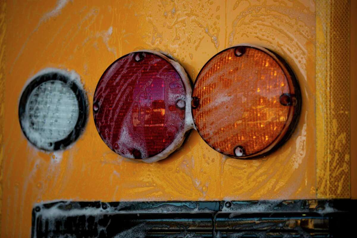 Detail of an Humble ISD school bus getting a wash on Thursday, June 11, 2020, in Humble in preparation for the new school year.