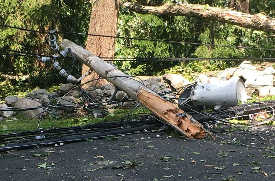 A utility pole lies in pieces along Nod Hill Road after it was snapped by high winds during Tropical Storm Isaias on Aug. 4. Photo: Contributed Photo / Wilton Bulletin Contributed