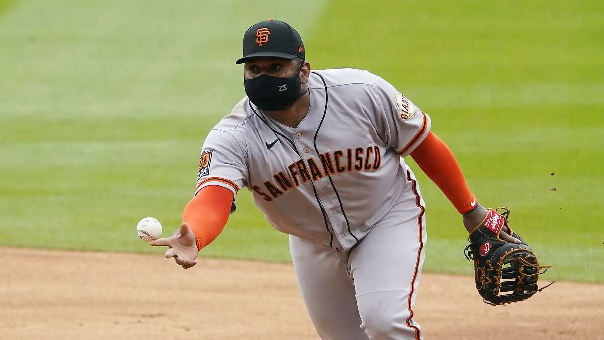 San Francisco Giants first baseman Pablo Sandoval tosses the ball to first against the Colorado Rockies during the third inning of a baseball game, Thursday, Aug. 6, 2020, in Denver. (AP Photo/Jack Dempsey)