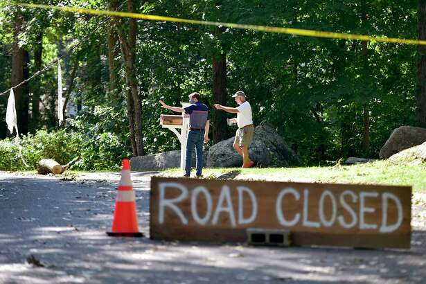 Guilford, Connecticut - Saturday, August 08, 2020: State Representative Sean Scanlon, left, and Ted Killiam, a Denison Drive of Guilford resident, survey Tropical Storm Isaias damage Saturday on Denison Drive.