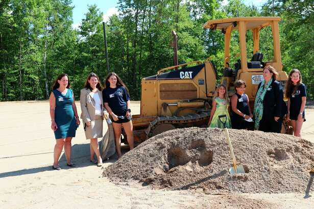 Maree Russo Mulvoy , owner and president of M R Products INC (second from right) with family and team members during the July 30 groundbreaking for new production and shipping facilities. (Courtesy Photo)