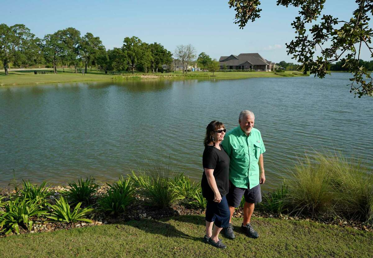 Linda Baker and Mike Baker are shown at the lake area of Mission Ranch Friday, Aug. 7, 2020, in College Station. The couple recently moved from Houston to College Station and are building at home in the master planned community.