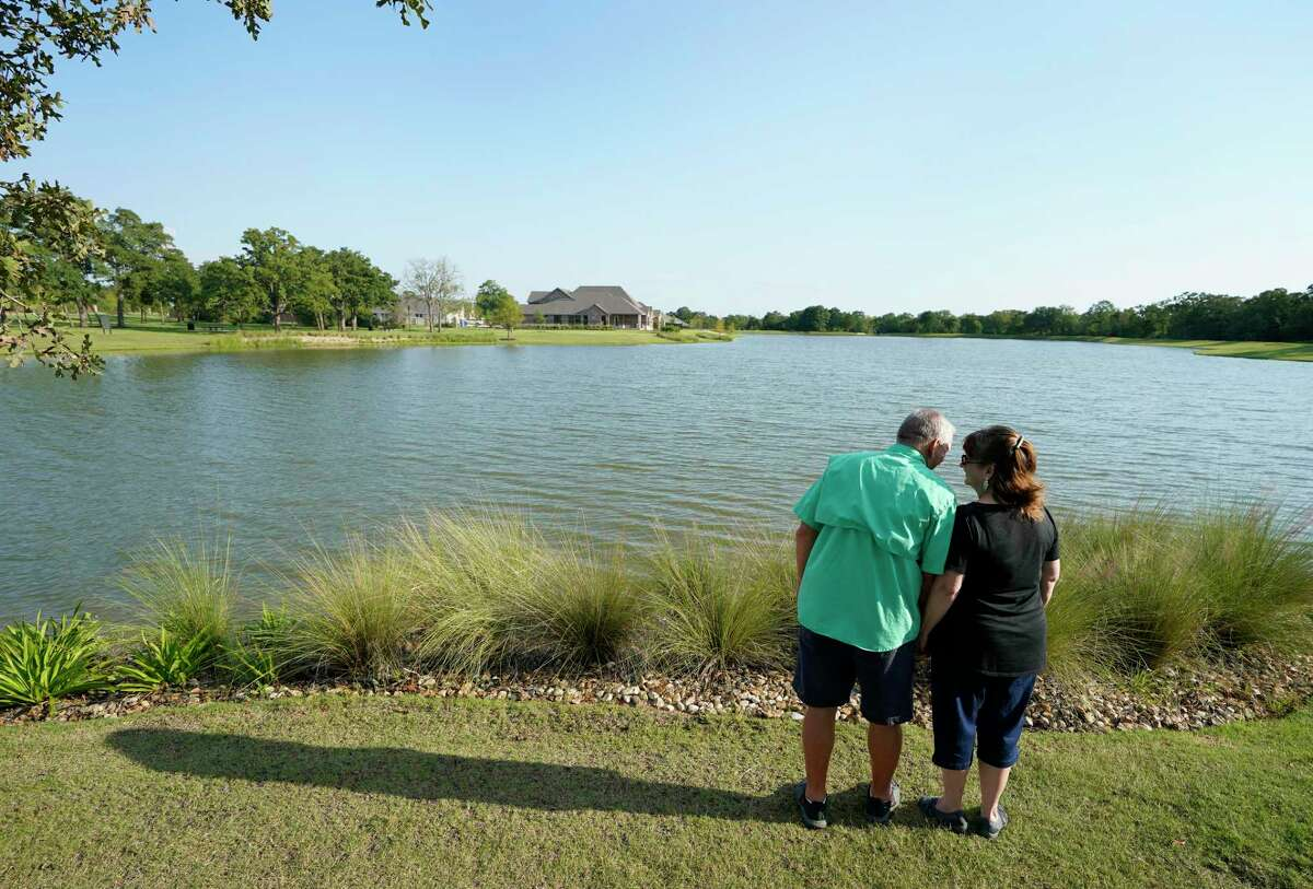 Mike Baker and Linda Baker are shown at the lake area of Mission Ranch Friday, Aug. 7, 2020, in College Station. The couple recently moved from Houston to College Station and are building a home in the master planned community.