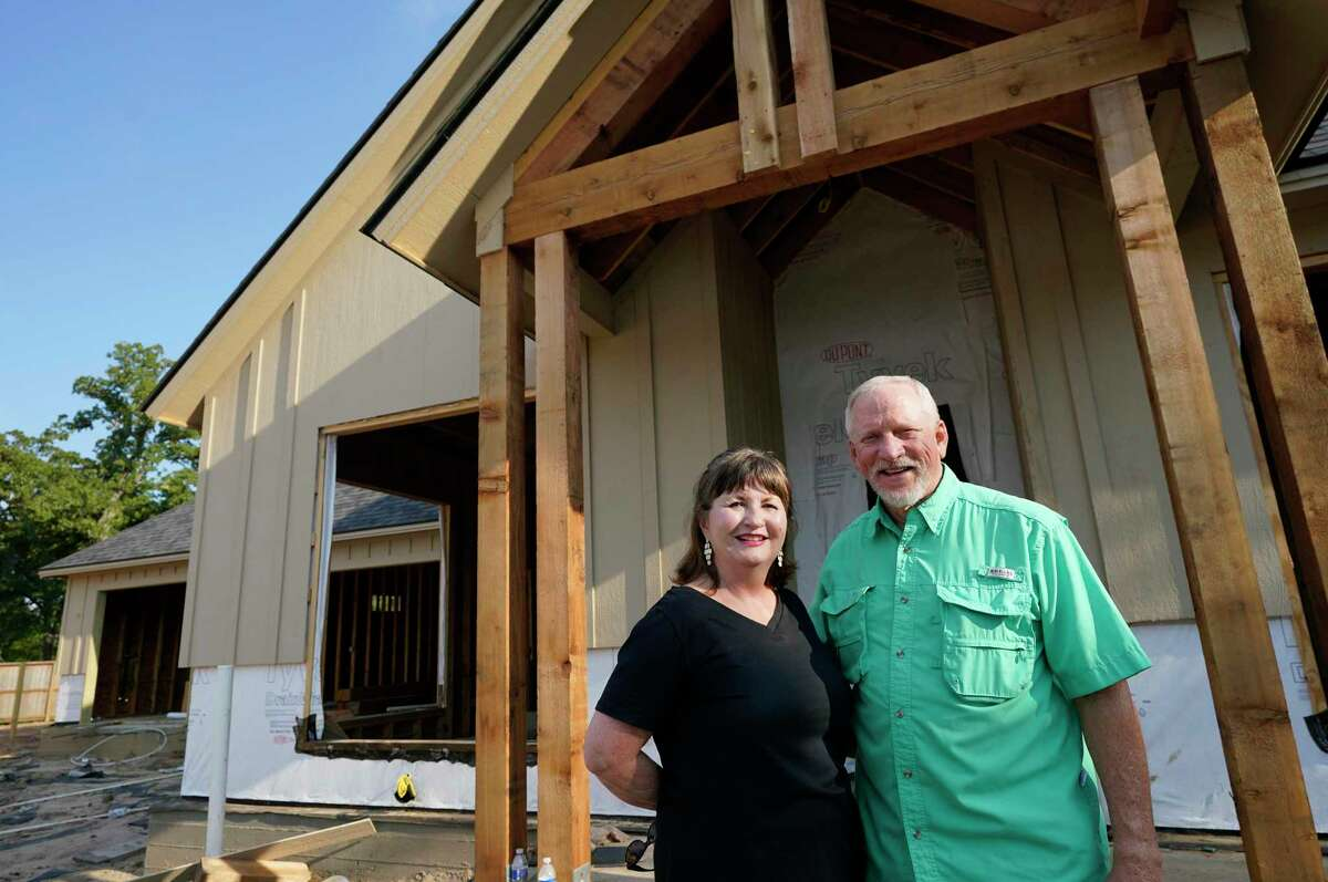 Linda Baker and Mike Baker are shown at the home they are having built in the master planned community Mission Ranch Friday, Aug. 7, 2020, in College Station.
