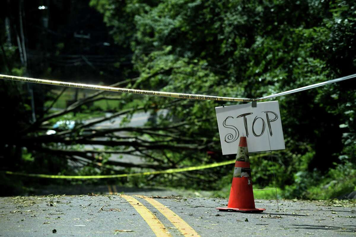 Route 33 remains impassable due to damage wrought by tropical storm Isaias Wednesday, August 5, 2020, which brought down trees with wind gusts up to 70 miles per hour in Norwalk, Conn.