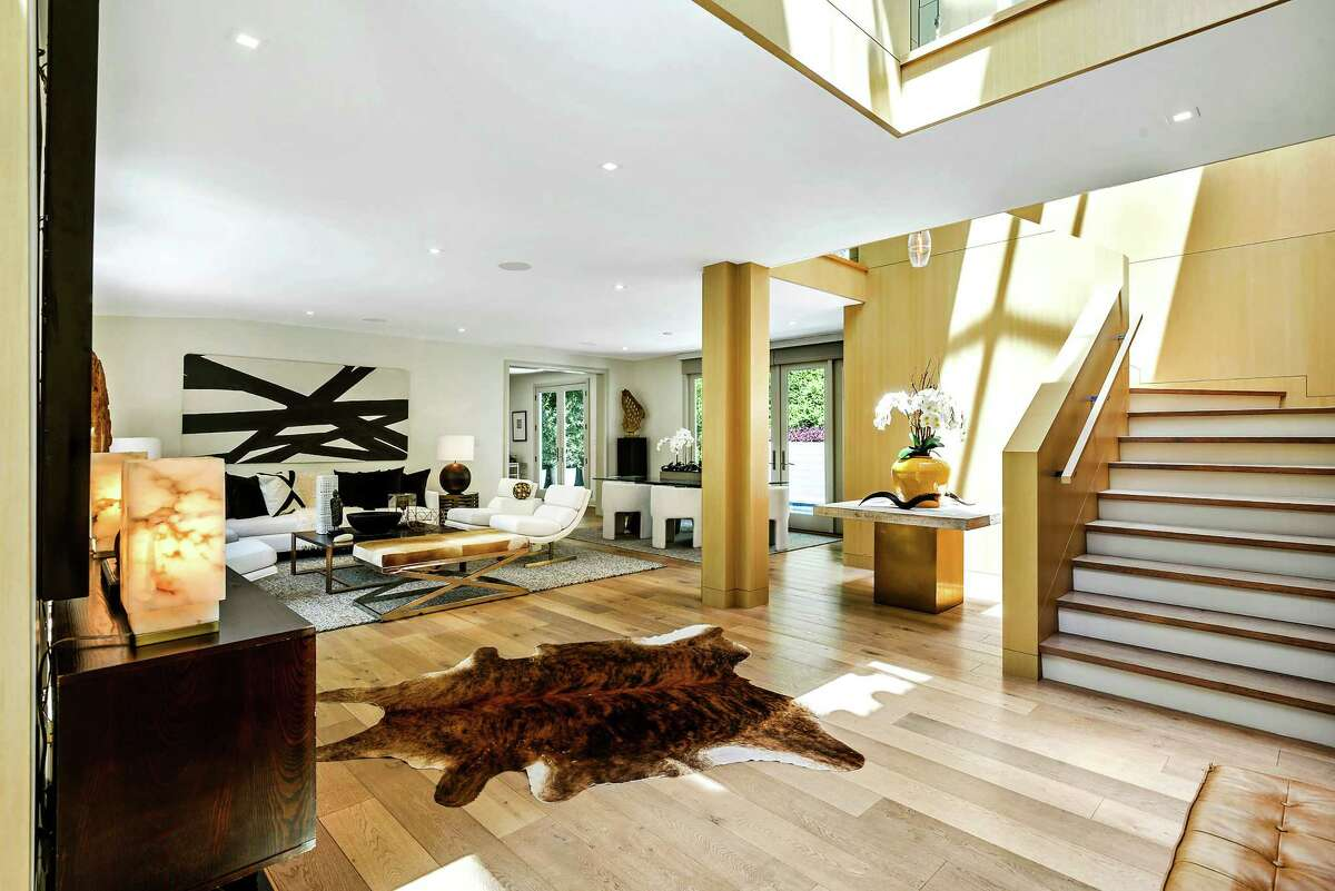 Former BET chairman and CEO Debra Lee has listed her Beverly Hills Post Office-area home of about five years for $3.495 million. The contemporary residence is surrounded by lush landscaping and features a catwalk that connects the upper level and an outdoor fireplace. (Paul Barnaby)