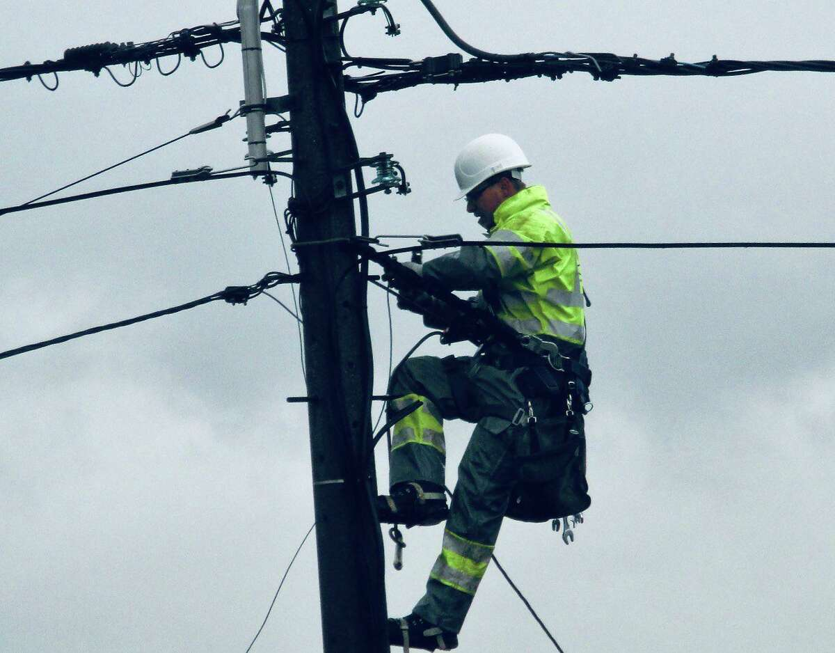 A utility worker making repairs in Bridgeport, Conn., on Saturday, Aug. 8, 2020.