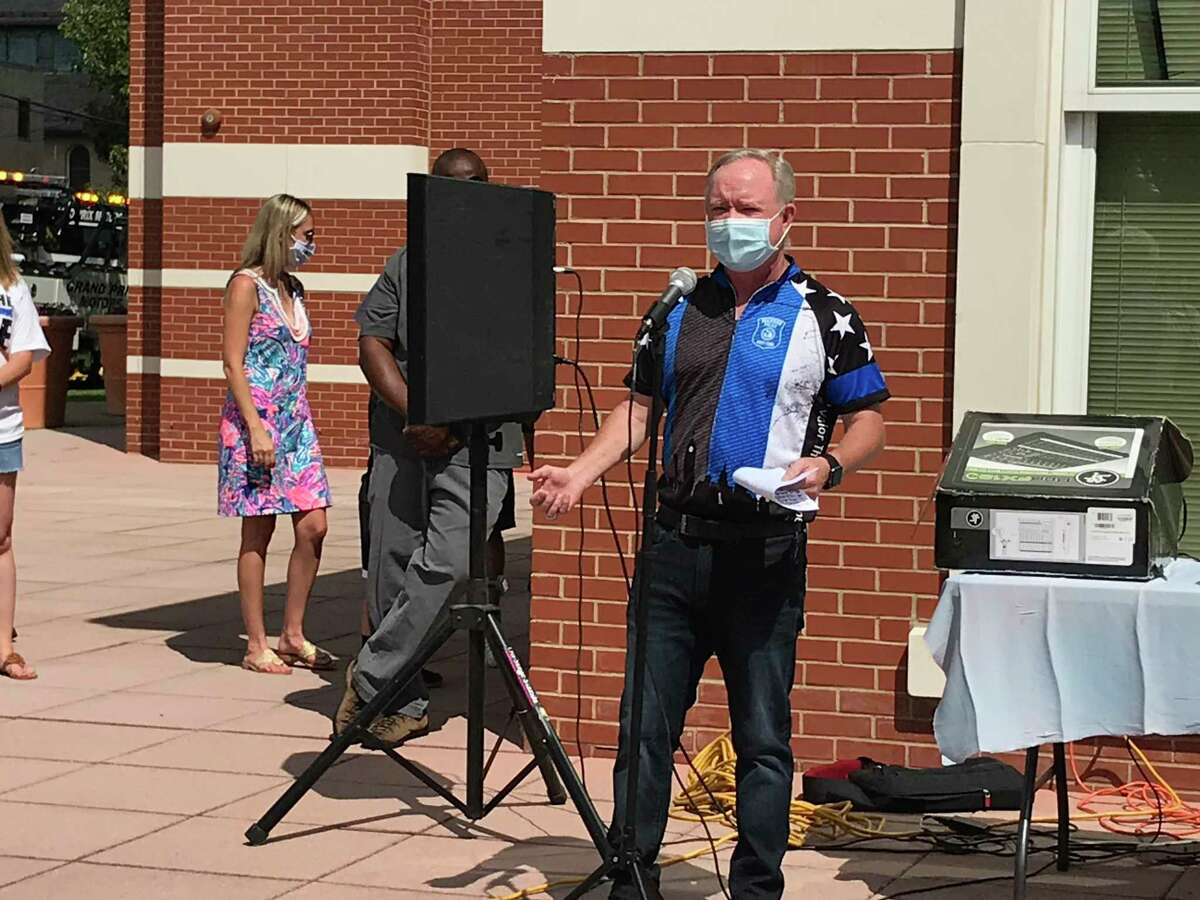 Danbury police Sgt. John Krupinsky speaks to the crowd at the
