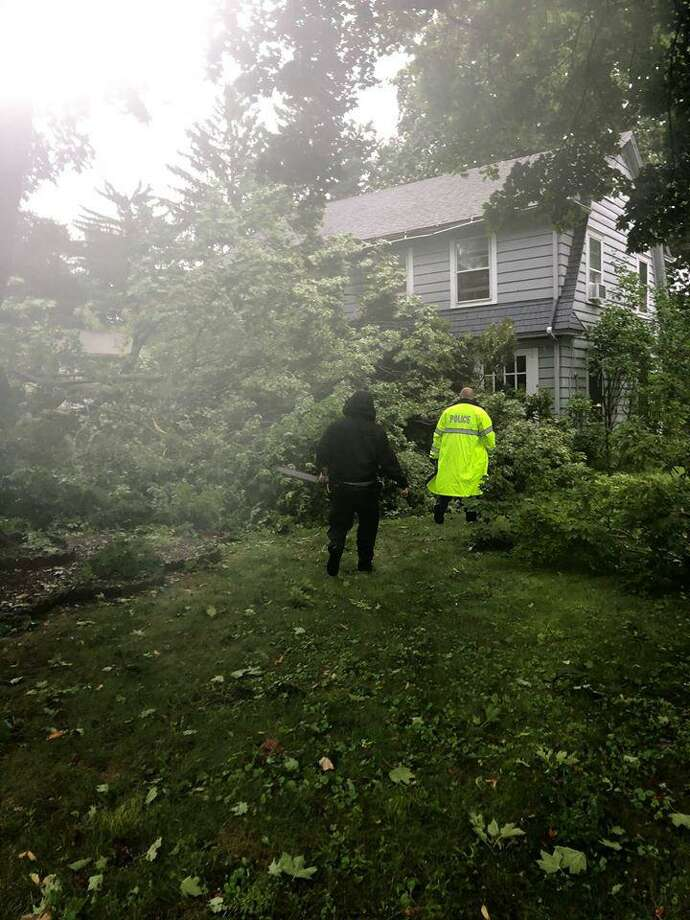 Three Danbury officers helped rescue a 61-year-old man trapped by fallen trees during tropical storm Isaias. Photo: / Contributed Photo /Danbury Police Department Facebook Page